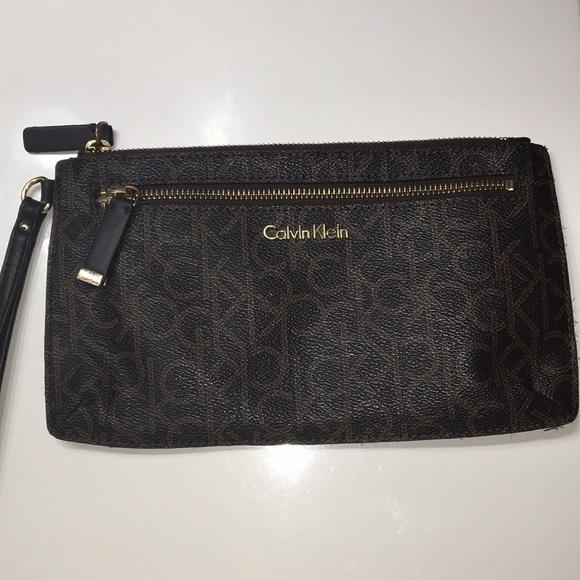ccbb5ea11a Calvin Klein Bags | Brown Ck Designed Wristlet | Poshmark